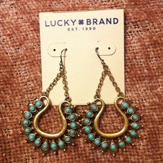 """Dangle Earrings Brassy gold colored dangle earrings with round turquoise (I think) stones. Hook backs. Measurements are approximate, but I try my best!! Length 2.45"""", width 1.5"""". Lucky Brand Jewelry Earrings"""