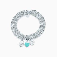 Return to Tiffany™ mini heart tags on sterling silver bead bracelets.