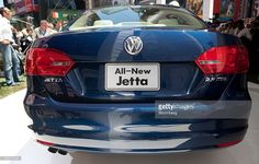 The new Volkswagen 2011 Jetta sits on display during its unveiling in New York, U.S., on Tuesday, June 15, 2010. Volkswagen AG plans to cut the U.S. price and increase the size of the Jetta compact car, its best-selling model in the country, as the automaker seeks to almost double sales in the market by 2012. Photographer: JB Reed/Bloomberg via Getty Images