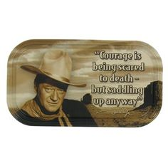 """Courage is being scared to death but saddling up anyway."" This tin magnetic sign featuring John Wayne is the perfect gift for fans of the legendary actor. 