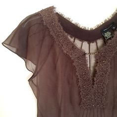 """BCBGMAXAZRIA Sheer Chocolate Silk Beaded Top BCBGMAXAZRIA sheer chocolate brown silk cap sleeve top.  Marked as an 8, but runs small. It fits closer to a 4.  Very good condition. Worn just a few times. 100% silk. Lace trim at v-neckline w/ iridescent beading. Wear a cami or """"meant to be seen"""" bra underneath. Discreet side snap closures. Bust measures approx 18"""" across the underarms, lying flat. Back length is approx 18.25"""" from collar to bottom hem. Smoke-free home. BCBGMaxAzria Tops"""