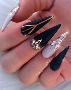 So gorgeous black stiletto nails with glitter, crystals amp; - - So gorgeous black stiletto nails with glitter, crystals amp; Gold Stiletto Nails, Gold Glitter Nails, Cute Acrylic Nails, Rhinestone Nails, Creative Nail Designs, Creative Nails, Nail Art Designs, Black Marble Nails, Black Nails