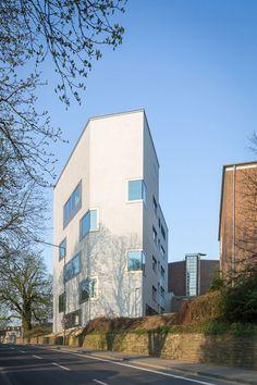 KSG Architekten - Textured walls + anodised gold window surrounds on a university lab in Aachen.