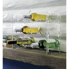 """clear wine rack in novogratz holiday collection   CB2   This see-through cellar was was designed exclusively for CB2 by husband-and-wife-design duo Robert and Cortney Novogratz. """"We wanted this piece to feel glam and modern, but sleek and discreet without adding kitchen clutter. Each rack holds four bottles, and you can stack up to three racks."""""""