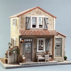 Miniature dollhouse cottage. Love the weathered stone and barrel tiles