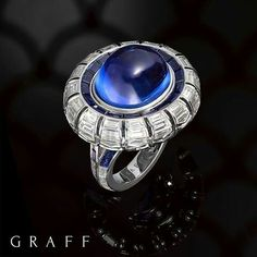 Breathtaking Blue. A single line of scintillating baguette-cut Diamonds flow rhythmically around the ring in a perfect circle, leading the eye to a single breathtaking stone - a captivating 21.80 carat oval cabochon Sapphire. Graff Diamonds. Unique Jewel.