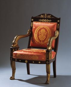Fauteuil de Cabinet France, circa 1800 Mahogany veneer, carved and parcel-gilt wood, gilt bronze