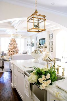 Christmas Home Tour 2017 - Silver and Gold Christmas in the kitchen with flowers in a Blanco sink and gold lanterns - Randi Garrett Design