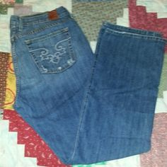"""Lucky Brand USA Made Jeans sz 16/33 Classic Rider Here's a just broken in pair of jeans by Lucky Brand Gene Montesano.  They're the classic rider style with a regular inseam of 32"""".  Size 16 or waist 33.  Intentional distressing on back pocket pressure points. Otherwise just a tiny bit of wear on cuffs. Made in the USA jeans for crazy cheap!  Thanks for looking :) Lucky Brand Jeans Straight Leg"""