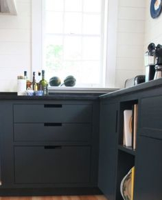 Flat cabinets, maybe with cutouts or brass pulls