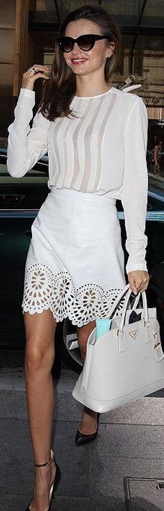 Miranda Kerr: Shirt – Dion Lee    Skirt – Lover    Shoes – Valentino    Purse and sunglasses – Prada
