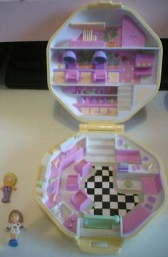 Polly Pocket! I can't believe they don't make them like this anymore. I would spend hours playing with these! Good thing I kept all of them so L will be able to enjoy them. =)