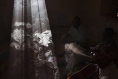 Men smoke in a room in Gao, Mali.  - Joe Penney—Reuters