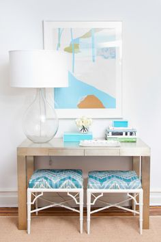 Hide extra seating  This is something I would like to do in my home. A small console table with two stools/ottomans tucked away underneath. Great for extra seating. | first apartment project. Good Bones, Great Pieces.