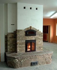 Stone, brick and stucco masonry oven/stove, Uxbridge, ON, Canada, Finish by Alex Chernov