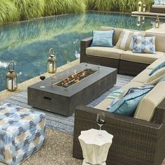 The clean, linear design of our Fayette Fire Table make this a stunning centerpiece for your outdoor area. Crafted of durable Envirostone , it features a wide rim that is the perfect spot for cocktails and plates of appetizers. Crafted of durable Envirostone Raw concrete finish Rated at 50,000 BTU's Durable stainless steel ring burner Includes 10 feet of commercial grade connector hose to attach to...