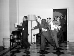 White House reporters dash for the telephones on December 7, 1941, after they had been told by presidential press secretary Stephen T. Early that Japanese submarines and planes had just bombed the U.S. Pacific fleet at Pearl Harbor, Hawaii.