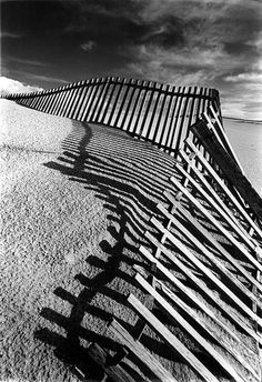 Broken Fence - love this black & white image and the shadow of the fence on the sand.... Captures the varying patterns and textures with the storm looming....