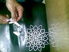 Watch this snowflake being cut ... tiny scissors. Pretty music, too.