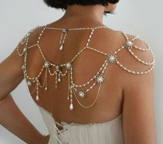 Back view of Alice Shoulder Necklace is a 1920's inspired necklace made of dozens of tiny ivory pearls and crystals curled by hand. Sterling silver metal filigrees with Swarovski rhinestones and pearls with thin silver chain between.