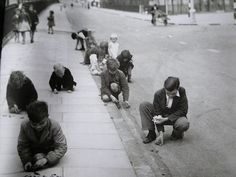 Children in a street in South London sorting shrapnel, anti-aircraft shell fragments, which they have collected as their contribution to the national war effort, 1 September 1940.