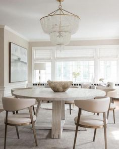 neutral dining room design, modern farmhouse dining room design with chandelier, round dining room table with upholstered chair and bead chandelier Large Round Dining Table, Round Dining Room Sets, Dining Table Design, Dining Table Chairs, Farm Tables, Wood Tables, Rustic Table, Contemporary Dining Room Furniture, Furniture Design