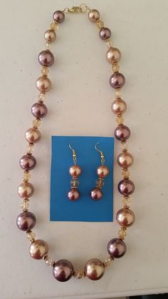 Black and golden pearls necklace with matching earrings