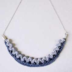 DIY tutorial for this super cool crochet statement necklace with a good many pictures for every step along the way.