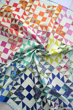 Electric Pop Quilt pattern by Tied with a Ribbon Fabrics are Tula Pink All Stars and Tula Pink Solids