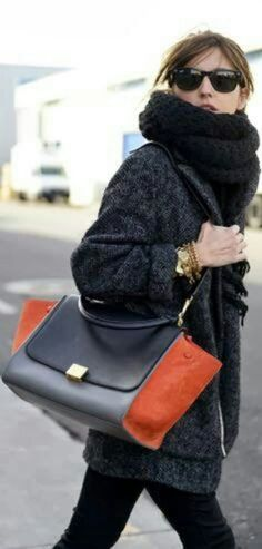 Love the big cowl, skinny pants, long jacket and geometric colorblock bag. (Celine bag)
