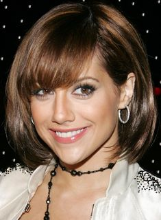 Brittany Murphy's short and fierce bob with side-swept bangs///repinning to pay homage.