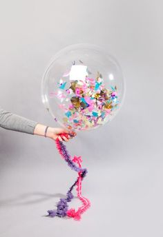 Of course clear balloons are Aunty Dawny's specialty! star sequins or origami stars would be best!