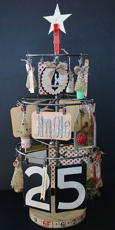 DIY.... mixed media Christmas tree... http://www.2gypsygirls.com/2011/12/day-7-oh-christmas-tree.html