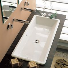 Features:  -Comfortable to use.  -Custom vanity required.  Installation Type: -Self rimming sink.  Style: -Modern.  Sink Shape: -Rectangular.  Finish: -Glossy white.  Material: -Ceramic.  Number of Fa