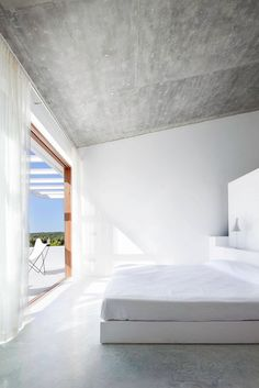 Concrete and plaster. Bedroom inside a house renovation/extension by Maria Castello Martinez.