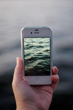 Taking in the sea through the iPhone