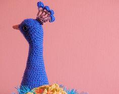 Crochet instructions for making a stunning peacock amigurumi.