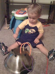 pipe cleaners and a colander = toddler entertainment. great for fine motor skills development