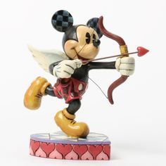 Jim Shore        Cupid Mickey Mouse     Mickey plays the role of cupid in this adorably sweet figure designed by Jim Shore. Made of stone resin, and stands approximately    6.125in H x 6in W x 4.25in L $45.00