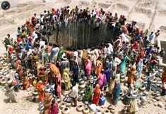 People gather water from a huge well in the village of Natwarghad in the western Indian state of Gujarat. More than 1 billion people still lack access to clean drinking water. [2003] These 75 Iconic Photos Will Define The 21st Century So Far. Everyone Needs To See This.