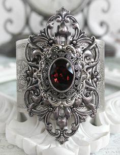 JANUARYS PASSION Victorian vintage gothic cuff bracelet in aged silver with Swarovski garnet, January birthstone. $64.00, via Etsy.