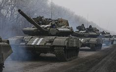 Ukrainian servicemen ride on a tank near Debaltseve, eastern Ukraine