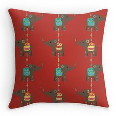 Elephant charms on red pillow http://www.redbubble.com/people/hollyddesigns