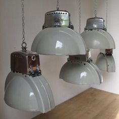 1950's industrial pendant lights removed from the former Kandem lighting factory in Leipzig, East Germany.