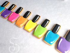 Even though I don't paint my nails very often these days, I love browsing the nail polish at drug stores and buying new colors. I kind of wish I had painted my nails in a neon rainbow before I filmed the tutorial for these nail polish cookies!Here's
