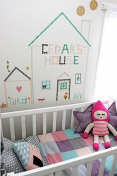 Make DIY tape art. This fun, easy project would be perfect for a kid's room. Collect an assortment of washi or other paper craft tapes, and start tearing and taping away. Stick with simple shapes, like the houses shown here, and letters for the best effect.