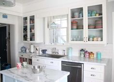 White and Glass Kitchen Cabinets