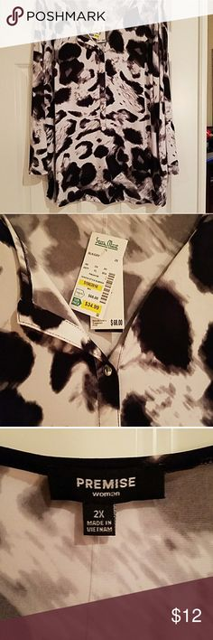 NWT 2X black and white tunic Easy-care and fun to wear black and white animal print tunic by premise. From shoulder to him at back is approximately 28 in. Bundle the save 20%. Premise Tops