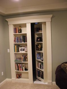 Secret Bookcase Door. Fun and mysterious idea for the basement, with the book shelf/hidden door for extra storage for kids stuff.