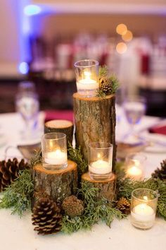 Winter-themed wedding centerpiece idea - tree branches, pinecones and candles - #weddingcenterpiece {Candice Adelle Photography}